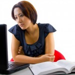 Thinkstock-adult-at-computer-open-book