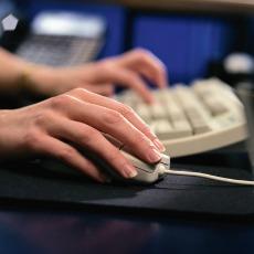 hands at computer.230