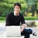 male student on laptop 230