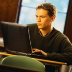 male student on laptop
