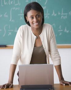 teacherwithcomputerinclassroom
