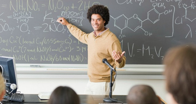 chemistry student at blackboard